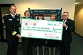 US Navy 070202-N-5758H-002 Commander, Navy Region Mid-Atlantic (CNRMA) Rear Adm. Rick Ruehe, presents a $3,750 check from the proceeds of Operation Jingle.jpg
