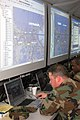 US Navy 070510-N-2456S-009 Lt. j.g. Roger Whitley, information watch officer, monitors a map of New Orleans during Navy Expeditionary Combat Command's (NECC) Echelon Exercise at Naval Amphibious Base Little Creek.jpg