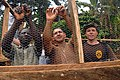 US Navy 071211-N-0193M-145 Construction Electrician 2nd Class Jose Castillo, center, takes time as an Africa Partnership Station (APS) volunteer to shows Limbe United Youth Associations volunteers how to secure chicken wire.jpg