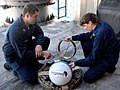 US Navy 080120-N-0493B-005 Mineman 2nd Class Matthew Rishovd, left, works with an unidentified Sailor to deploy a National Oceanic and Atmospheric Administration drifter buoy off the coast of Senegal.jpg