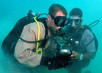 Buddy diving - A Navy buddy diver team checking their gauges together