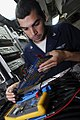 US Navy 080711-N-3946H-013 Aviation Electronics Technician 3rd Class Justin Gonzalez, of San Antonio, Texas, troubleshoots the radar system of an EA-6B Prowler assigned to Electronic Attack Squadron (VAQ) 136.jpg