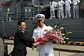 US Navy 080714-N-6806R-002 Vice Mayor Yamamura welcomes Cmdr. Dave Haas, commanding officer of the guided-missile frigate USS Thach (FFG 46), and his crew, to the city of Shimonoseki at the start of a routine port visit.jpg
