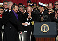 US Navy 090110-N-4408B-405 Capt. Kevin E. O'Flaherty, commanding officer of the aircraft carrier USS George H.W. Bush (CVN 77), welcomes former President George H.W. Bush to the commissioning ceremony for the aircraft carrier U.jpg