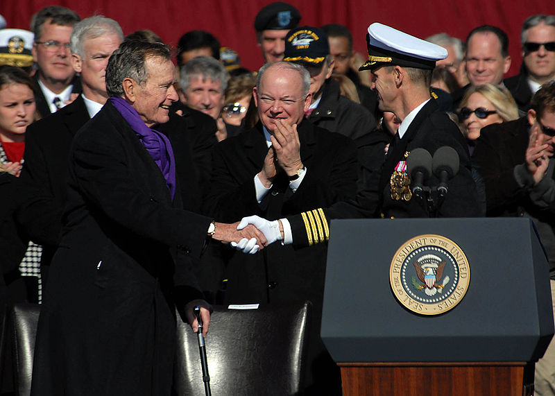 File:US Navy 090110-N-4408B-405 Capt. Kevin E. O'Flaherty, commanding officer of the aircraft carrier USS George H.W. Bush (CVN 77), welcomes former President George H.W. Bush to the commissioning ceremony for the aircraft carrier U.jpg