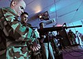 US Navy 090129-N-0807W-112 Sailors reload laser-emitting M16 rifle simulators during the grand opening of the indoor weapons training facility at Fleet Activities Sasebo.jpg