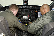 US Navy 090219-N-9552I-030 Naval Aircrewmen 1st Class Troy Rudisill and David Williams conduct pre-flight checks in the cockpit of a Gulfstream C-20A-G III