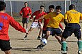 US Navy 090308-N-3830J-066 Yeoman 1st Class Andre Dortrait, assigned to the amphibious command ship USS Blue Ridge (LCC 19) maneuvers between Republic of Korea Navy soccer team members during a soccer game.jpg