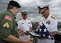 US Navy 090530-N-5366K-012 Bob Engstrom, left, presents a flag to Vice Adm. Dirk Debbink, Chief of Navy Reserve, to honor POW-MIAs at the remembrance table ceremony during the Southern Wisconsin AirFest 2009.jpg