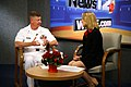 US Navy 090610-N-3271W-008 Master Chief Petty Officer of the Navy (MCPON) Rick West is interviewed by Rachel Oesch on the morning show at WDEF (CBS-12).jpg