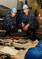 US Navy 091201-N-9116S-186 Seaman Scott A. Cloar nd Boatswain's Mate 3rd Class Rene Barriere prepare underway replenishment gear for inspection.jpg