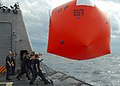 US Navy 100204-N-7058E-748 Sailors launch a Killer Tomato target from the littoral combat ship USS Freedom (LCS 1) before a surface gunnery exercise off the coast of Florida.jpg