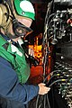 US Navy 100522-N-4516G-056 Aviation Machinist's Mate 1st Class Wade A. Carr troubleshoots an electrical junction panel for a test cell engine run on an F-A-18 engine aboard the aircraft carrier USS Enterprise (CVN 65).jpg
