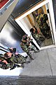 US Navy 101106-N-4044H-025 Navy SEALs enter a simulated home while practicing close quarters combat at U.S. Training Center Moyock.jpg