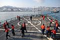 US Navy 110209-N-9818V-067 Sailors aboard the guided-missile destroyer USS Fitzgerald (DDG 62) secure mooring lines after departing Otaru, Japan.jpg