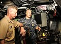 US Navy 110418-N-UK333-022 Master Chief Sonar Technician (Submarine) Rory Wohlgemuth explains the controls and operations of the boat to Master Chi.jpg