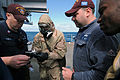 US Navy 110508-N-AE328-020 Damage Controllman 2nd Class Aaron Shields, left, and Engineman 1st Class Brian Rose, second from right, conduct trainin.jpg