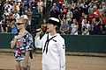 US Navy 110813-N-HN795-817 Musician 3rd Class Michelle Werner performs the national anthem at the start of a Fargo-Moorhead RedHawks baseball game.jpg