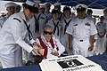 US Navy 110914-N-ZC343-551 Sybil Stockdale, widow of Adm. James B. Stockdale, cuts a cake during a ceremony to commemorate POW-MIA Day at Naval Bas.jpg