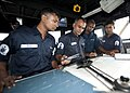 US Navy 110922-N-HA376-241 Bangladesh Navy Sailors look over a navigation chart on the bridge of the guided-missile frigate USS Ford (FFG 54).jpg