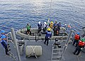 US Navy 111011-N-VH839-013 Sailors assigned to the Arleigh Burke-class guided-missile destroyer USS Dewey (DDG 105) lower a rigid-hull inflatable b.jpg