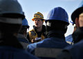 US Navy 111202-N-ZF681-004 Boatswain's Mate 2nd Class Jason Connole relays orders to line handlers aboard the guided-missile destroyer USS Halsey (.jpg