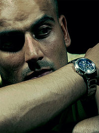 Umar Khan posing with a wristwatch.jpg