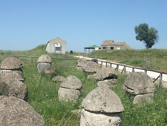 Monterozzi necropolis - buildings now replace the surface mounds (tumuli) to protect the subterranean tombs. Foreground: early Villanovan tombs