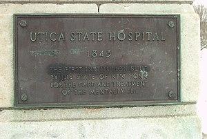 Utica Psychiatric Center - Plaque on gateway pillar on Court Street