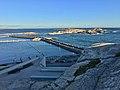 """Verdens ende, Tjøme, Norway. Færder National Park. View of Oslofjorden towards Skagerak. Breakwater (molo), port (gjestehavn), etc. Part of """"promenadebrygga"""" etc. Light and shadows from sunset.2018-09-12 H.jpg"""