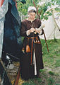 Viking female using the drop spindle.jpg