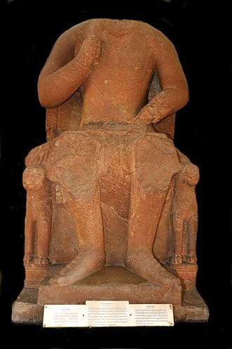 Vima Kadphises - Vima Kadphises on throne. The name of Vima Kadphises is mentioned in an epigraphic inscription at the feet of the statue. Mathura Museum.