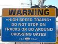Warning sign on TRAX line crossing.JPG