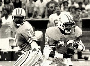 History of the Houston Oilers - AFC Pro Bowlers Warren Moon (left) and Mike Rozier (right) made major contributions to the Oilers' offense in the late 1980s while leading the team to several playoff appearances.