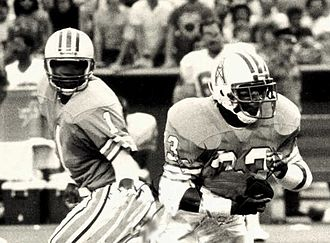 Warren Moon - Moon (left) playing with teammate Mike Rozier for the Houston Oilers in 1987.