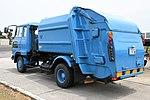 Waste collection truck(Hino Ranger) left rear view at JASDF Miho Air Base May 27, 2018.jpg