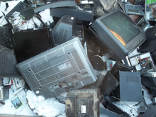 Waste electrical items accumulate at a dump.