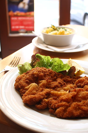 Austrian cuisine - Wiener Schnitzel, a traditional Austrian dish made with boneless meat thinned with a mallet (escalope-style preparation), and fried with a coating of flour, egg, and breadcrumbs