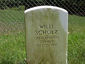 Fort Leavenworth Military Prison Cemetery - A headstone in the back row (11th) of a German POW buried at the site.  This prisoner was hanged for the murder of Johannes Kunze.