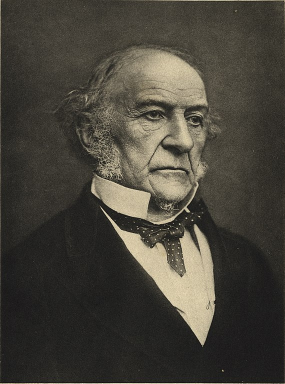 a photograph of an old man with a messy collar and bow tie