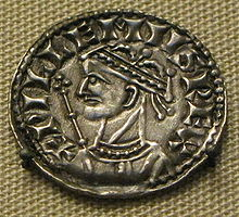Coin image of a crowned male head with a sceptre in the background