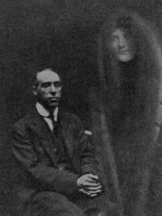 """Harry Price - A photograph by William Hope showing Price with a """"spirit"""""""