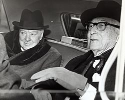 Sir Winston Churchill, British statesman, and Bernard Baruch, financier, converse in the back seat of a car in front of Baruch's home.