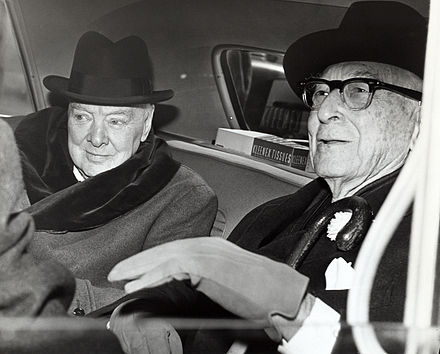 Winston Churchill and Bernard Baruch converse in the back seat of a car in front of Baruch's home. Winston Churchill and Bernard Baruch talk in car in front of Baruch's home, 14 April 1961.jpg