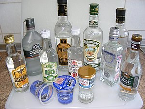 Russian cuisine - Russian vodkas in various bottles and cups
