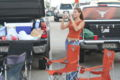 Woman at a tailgate party for a UT football game.JPG