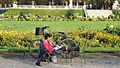 Woman with bicycle, Jardin du Luxembourg, 25 October 2012.jpg