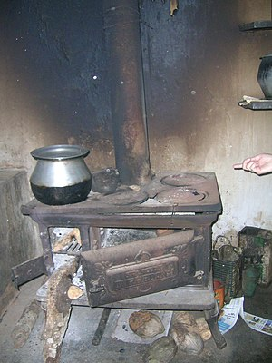 Wood-burning stove - Spencer woodstove in British bungalow at Pollibetta, India.