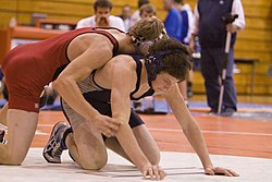 This scholastic wrestling match (featuring high school students) resumes in the referee's position.