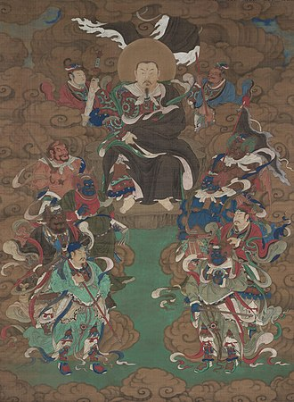 Xuanwu (god) - A Ming painting of Xuanwu in his position as Xuantian Shangdi (Supreme Emperor of the Dark Heaven), seated on a rock throne in the clouds surrounded by attendants and divine marshals